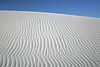 Gypsum Sand of the White Sands National Monument - when evaporated from the Lake Lucero, is wind transportated to form the dunes, which can move 30 ft. (9 m) per year.
