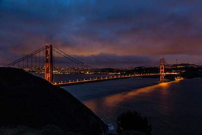 The Golden Gate Bridge not long after sunset on a cloudy evening.