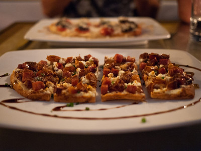 Stone Baked Spanish Flatbreads from Fin in Key West, FL.  Medjool date, goat cheese, Serrano ham and sherry syrup.