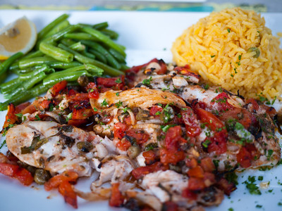 "Matecumbe from from Fish House Encore in Key Largo, FL.  ""Topped with fresh tomatoes, shallots, basil, capers, olive oil and lemon juice, then baked.  The Fish House's original creation, often copied, but never duplicated!  Featured on The Food Network Food Nation with Bobby Flay and in Cooking Light Magazine."""