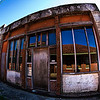The depot reflected in abandoned building. Tyler Texas.