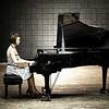 At the Grand Piano