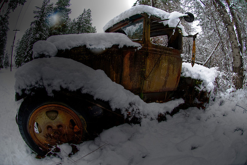 Vintage Tow truck in snow.