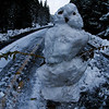 Snow Man on the road.