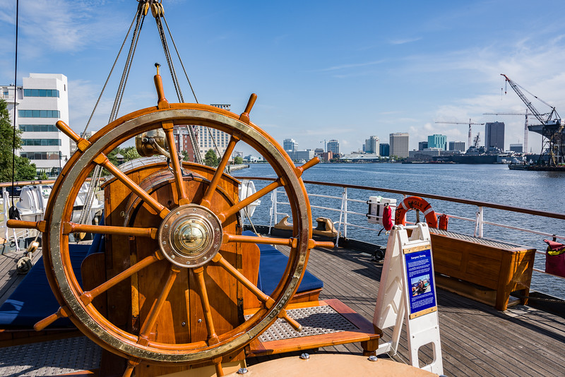 The Old Wooden Traditional Ships' Wheel of the USCGC Eagle with Norfolk, Virginia in the Background