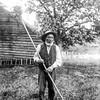 Grandfather holding rake