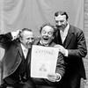 W Myloris, Pitrot & Richards reading N.Y. Figaro