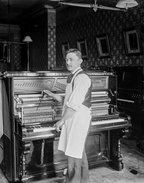 Henry repairing a 'William Mylius' piano