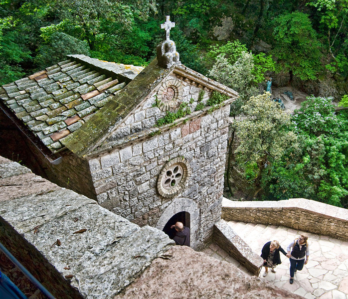 Eremo delle Carceri, St. Francis' remote mountain top prayer retreat where he lived in a cave, high above Assisi. Sacred pilgramage for Catholics, a spiritual place for all. HIs cave is in the grotto below.