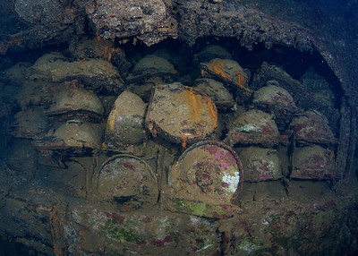 "Beach mines (approx 2 ft. in diameter) in the hold of the San Francisco Maru.  The San Francisco is the ""Million Dollar Wreck"", since she went down fully loaded.  In addition to these mines, the holds are packed with 500 lb aerial bombs, artillery shells, detonators, vehicles and all kinds of other materiel."