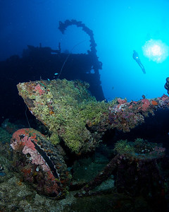 Artillery, davit, and diver.  Nippo Maru.