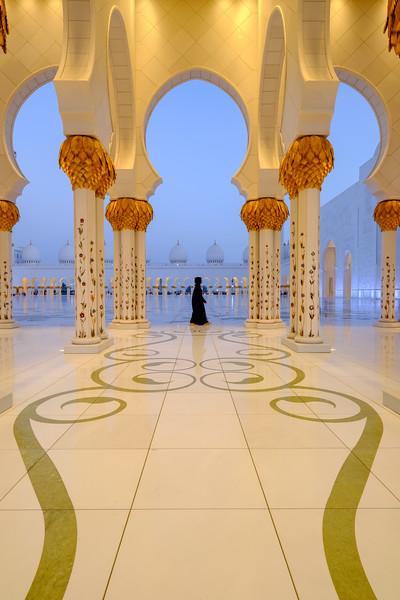 Lady walking at Sheik Zayed Grand Mosque, Abu Dhabi