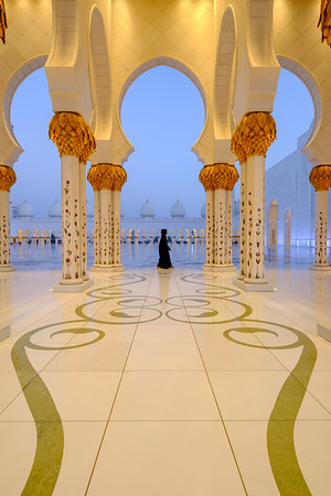 Lady walking at Sheik Zayed Grand Mosque, Abu Dhabi