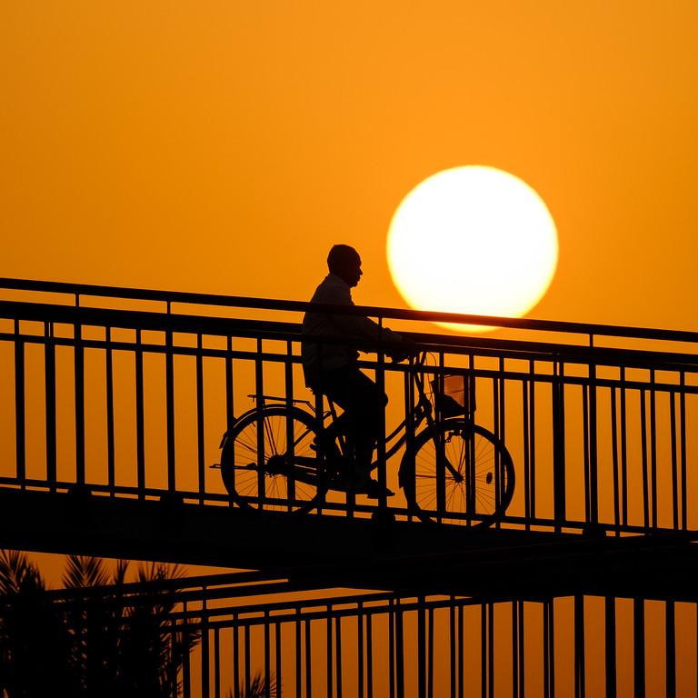 Riding the bike at sunset, Dubai