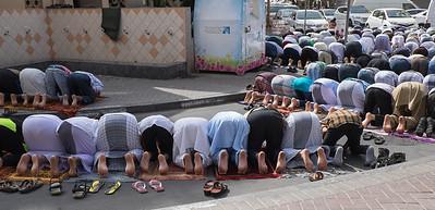 Group praying in Deira, Dubai