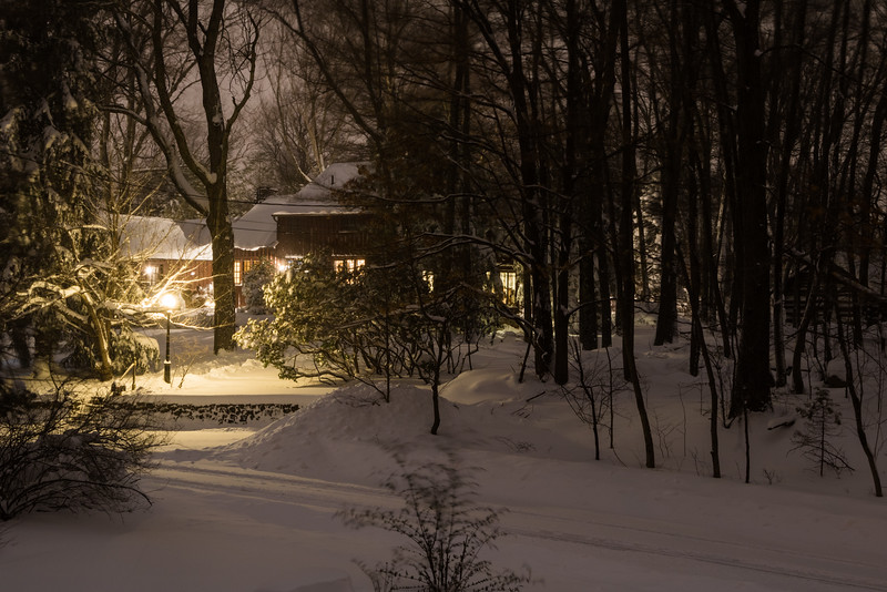 Mansion at night after snow storm