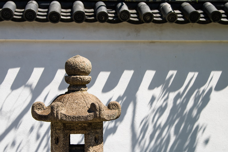 Japanese lantern in the shadow of a wall