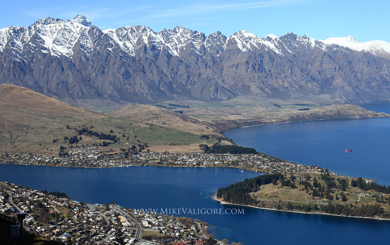 Queenstown<br /> <br /> A paraglider can be seen across the valley from the top of Bob's Peak in Queenstown, New Zealand.