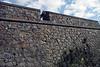 Cannon thru the stone embrasure along the rampart of the Bastión de San Miguel - Colonia del Sacramento town.