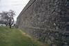 Dry moat along the stone wall of the Bastión de San Miguel - beyond to the Rio de la Plata (River of Silver) - Colonia del Sacramento town.