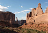 Afternoon sunlight upon the north end of Park Avenue - down to the shadowed Sheep Rock, and southwestern end of the Tower of Babel - Arches National Park