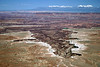 Over the White Rim - into the Gooseberry Canyon (Colorado River below) - Canyonlands National Park - to the snow-capped La Sal Mountains, along the distal horizon