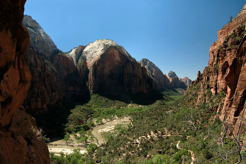 From the shaded western slope of Angels Landing - down the North Fork Virgin River and Zion Canyon - with the lower sunlit slope of Cathedral Mountain and The Spearhead (R) - and the shaded Great White Throne, Red Arch Mountain, Mountain of the Sun, Twin Brothers, and the distal sunlit Mount Spry - Zion National Park