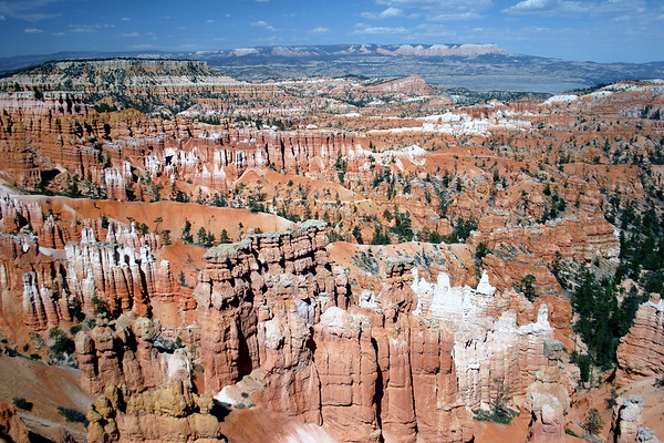 Across the hoodoos and fins - Boat Mesa and the Sinking Ship - Bryce Canyon National Park - with the Aquarius Plateau along the distal horizon, under the cumulus clouds
