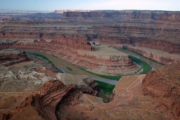 """Dead Horse Point - down to the Potash Road, along the Colorado River, at the north end of the """"Goose Neck"""" - Dead Horse Point State Park - southward across the Musselman Canyon - to the """"Island in the Sky Mesa"""" (including the shaded Grays Pasture and the sunlit Grand View Point behind) - Canyonlands National Park"""