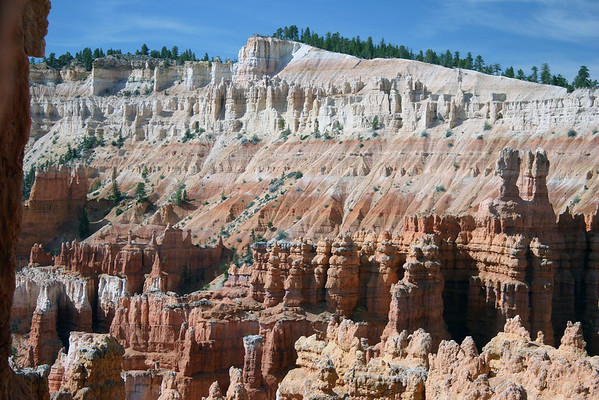 "From the edge of a limestone hoodoo - across to Inspiration Point - along the ""Pink Cliffs"" of the Paunsaugunt Plateau - Bryce Canyon National Park"