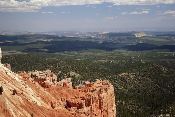 """From the iron oxide rich limestone at Yovimpa Point (""""Pink Cliffs"""") - at the southern section of Bryce Canyon National Park - down to the cumulus cloud shadows along the White Cliffs (2nd strata of the Grand Staircase) - Deer Range Point (L) - and Calf Pasture Point (R) - with No Mans Mesa and Mollies Nipple beyond"""