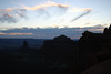 Sunset from the silhouettes of Muffin Butte and Candlestick Tower - Canyonlands National Park