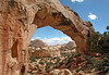 Southeast view through the Hickman Natural Bridge - to Capitol Dome (R) - Capitol Reef National Park