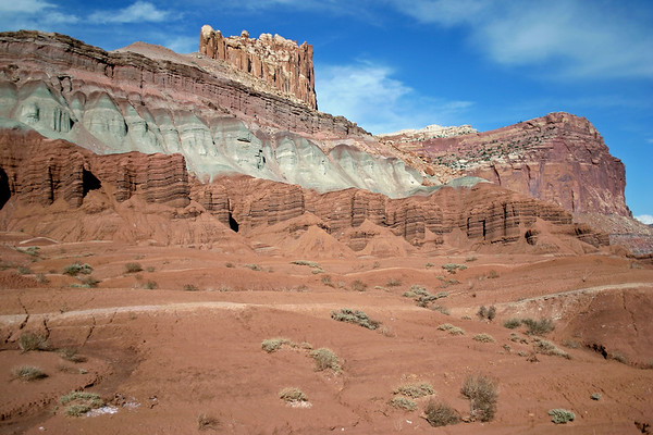 "Northwestern view of ""The Castle"", from Whiskey Flat - geologic sedimentary strata (sandstone, siltstone, and mudstone) are the Moenkope (bottom), Chinle, Wingate, Kayenta (upper) - Capitol Reef National Park"