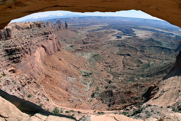 """Beneath Mesa Rock, along the eastern rim of """"Island in the Sky Mesa"""" - to Washer Woman Arch and Airport Tower, directly behind - Buck Canyon - Canyonlands National Park - with the La Sal Mountains along the distal horizon"""