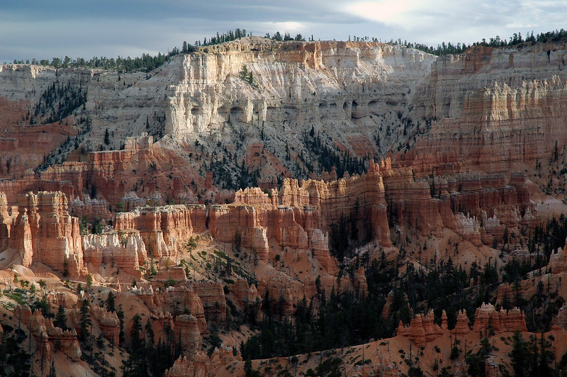 Day's last sunlight across the sedimentary sandstone hoodoos and fins below the rim of the Paunsaugunt Plateau (between Bryce Point and Inspiration Point) - Bryce Canyon National Park