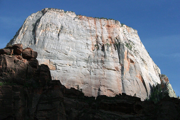 """Across the mostly shaded ridge of """"The Organ"""" (eastern arm of Angels Landing, forming the """"Big Bend"""") - to the sunlit Navajo sandstone, along the upper north face of """"The Great White Throne"""" - Zion National Park"""