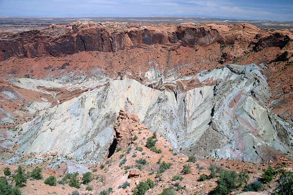 Upheaval Dome (about 3 mi.- 5 km diameter) - circular deformed anticline, surrounded by a downwarp in the rock called a syncline - Canyonlands National Park