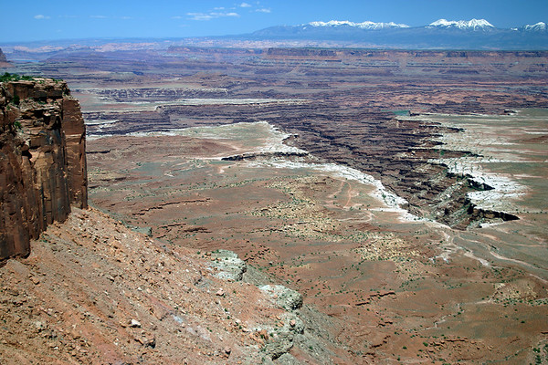 From the rim of Island in the Sky Mesa - down to the White Rim of Gooseberry Canyon - Canyonlands National Park - to the distal snow capped La Sal Mountains