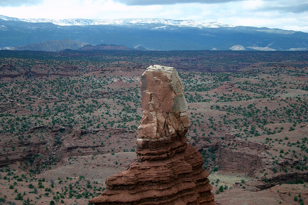 From the Windgate sandstone caprock of Chimney Rock - across the Sulphur Creek Gorge - Capitol Reef National Park - to Lion Mountain - and the snow-capped ridge along the Boulder Mountains