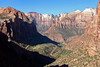"""West view from the shaded cliff of """"Bridge Mountain"""" and sunlit sandstone cliff of """"The East Temple"""" - across to the """"Streaked Wall"""", with """"Bee Hive Peak"""" directly above - then beyond to the """"Towers of the Virgins"""" (""""The West Temple"""", the vegetated and red rounded sandstone cap, """"Sundial"""", arched peak, and the """"Altar of Sacrifice"""", flat vegetated top, with red iron oxide streak down the white cliff face) - Zion National Park"""