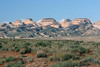 Eastern view of the Waterpocket Fold - with the Golden Throne (showing the rounded and shaded cap, with a totally sheer and smooth eastern face, and knurled sloping northern face) - Capitol Reef National Park