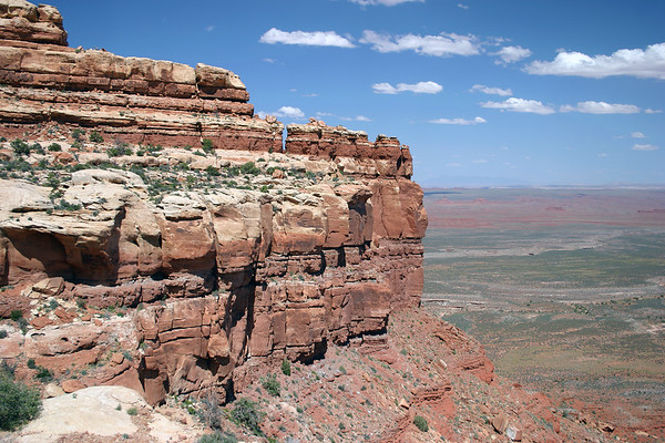 """Along the rim of Cedar Mesa - 1,200 ft. (366 m) down, to the """"Valley of the Gods"""" under the cumulus clouds - southeastern Utah"""
