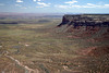 From the rim of the Cedar Mesa, at Moki Dugway - viewing southwest, over the mesa tip and past the San Juan River Gorge - to the distal north end of, the Monument Valley Navajo Tribal Park