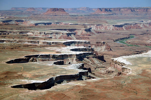 From the White Rim at Soda Springs Basin - to the Green River - Canyonlands National Park - to the distal Orange Cliffs at Lands End, Bagpipe Butte (6,679 ft. - 2,036 m), Elaterite Butte (6,552 ft. - 1,997 m), and Ekker Butte (6,226 ft. - 1,895 m) - Glen Canyon National Recreation Area - with the snow-capped Mt. Hillers, rising to 10,723 ft. (3,268 m).