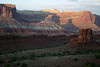 """From the shaded sandstone rock at Sunset Point - across to """"The Castle""""- with its evening shadow upon the northern section (western face) of the Waterpocket Fold beyond - Capitol Reef National Park"""