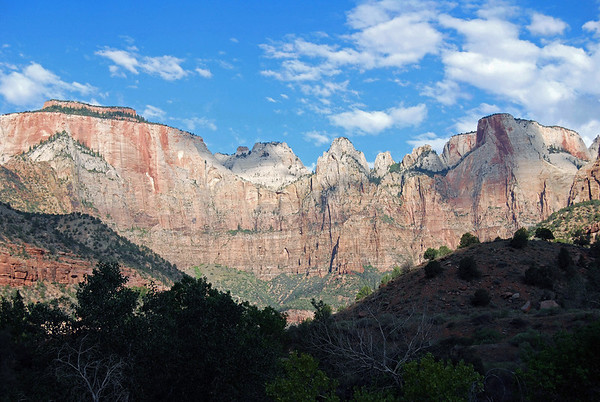 "Beyond the shaded lower slopes, up to the ""Towers of the Virgin"" - with The West Temple (L) being the highest feature in Zion Canyon (7,810 ft. - 2,380 m) - Sundial (C) - and shaded by the cumulus cloud, is the Altar of Sacrifice - Zion National Park"