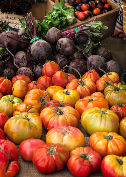 Heirloom tomatoes and red beets at farmer's market
