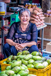 Happy fruit vendor.