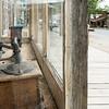 Coffee grinder in store window (empty boardwalk)